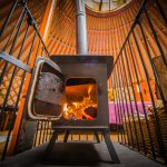 Log fire at Hidden Valley Yurts glamping holiday site Wales