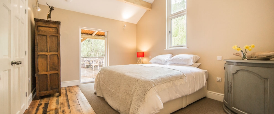 Super king bed wood Lake House large bedroom holiday Wales