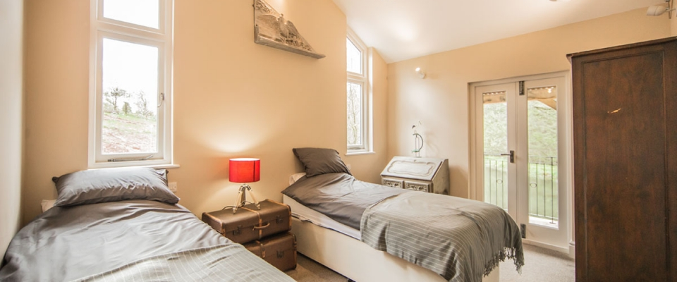 Twin bedroom in The Lake House holiday accommodation South Wales