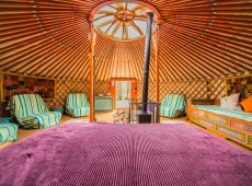 King size bed inside one of the luxury yurts at our glamping site